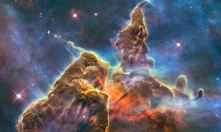 "<strong>Image of the Carina Nebula's ""Mystic Mountain""</strong><br />Radiation and fast winds from super-hot newborn stars shape and compress the pillar of the Carina Nebula, causing new stars to form. Credit: NASA, ESA, M. Livio and the Hubble 20th Anniversary Team (STScI)"
